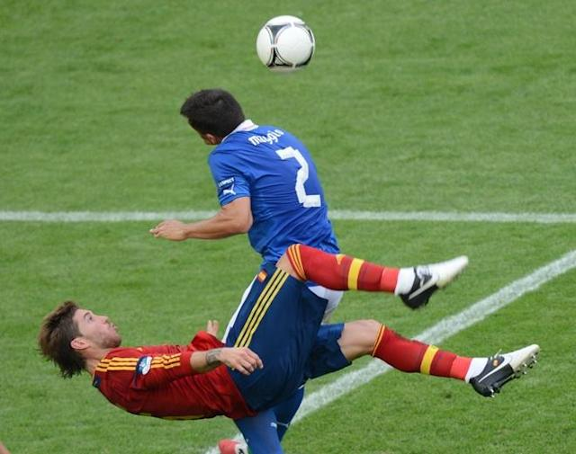 TOPSHOTS Spanish defender Sergio Ramos (L) vies with Italian defender Christian Maggio during the Euro 2012 championships football match Spain vs Italy on June 10, 2012 at the Gdansk Arena. AFPPHOTO/ PATRIK STOLLARZPATRIK STOLLARZ/AFP/GettyImages