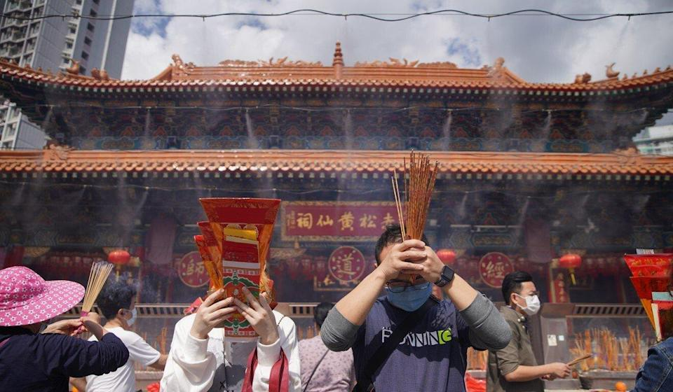 Worshippers make offerings at Sik Sik Yuen Wong Tai Sin Temple ahead of Lunar New Year. Photo: Winson Wong