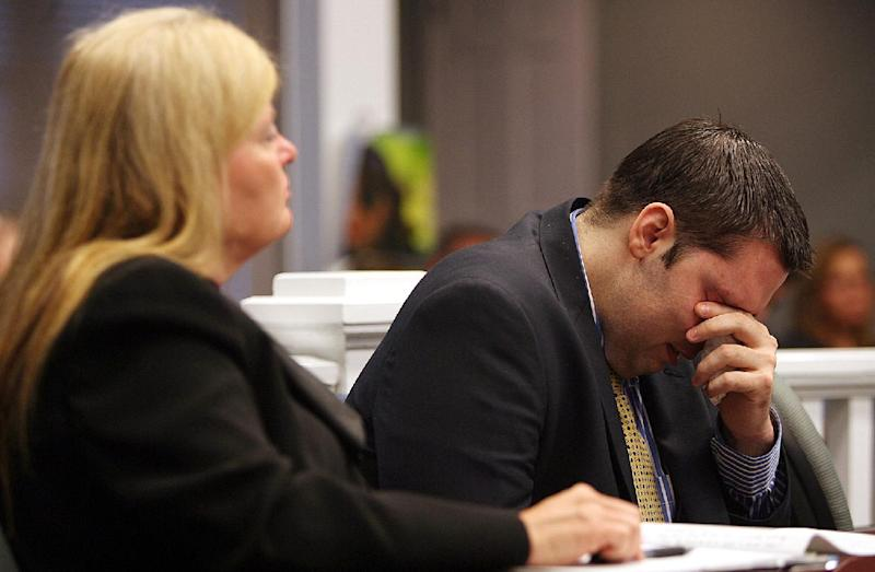Army Sgt. Anthony Peden flanked by his attorney Melinda Ryals wipes tears from his eyes Thursday, May 1, 2014, in Ludowici, Ga., as he listens to an outline of the events of Dec 2011 when he shot and killed teenager Tiffany York in Long County, Ga. Peden was sentenced to life in prison Thursday by a southeast Georgia judge for the December 2011 slayings of 17-year-old Tiffany York and her boyfriend, former soldier Michael Roark. (AP Photo/Lewis Levine)