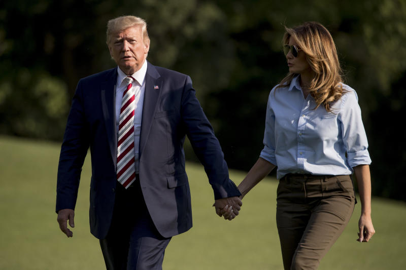 President Donald Trump and first lady Melania Trump walk across the South Lawn of the White House in Washington, Sunday, Aug. 4, 2019, as they arrive back from Bedminster, N.J. (AP Photo/Andrew Harnik)