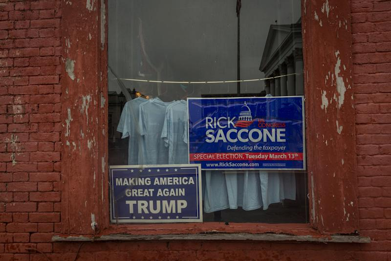 A window announcing support for Congressional candidate Rick Saccone is seen in Waynesburg