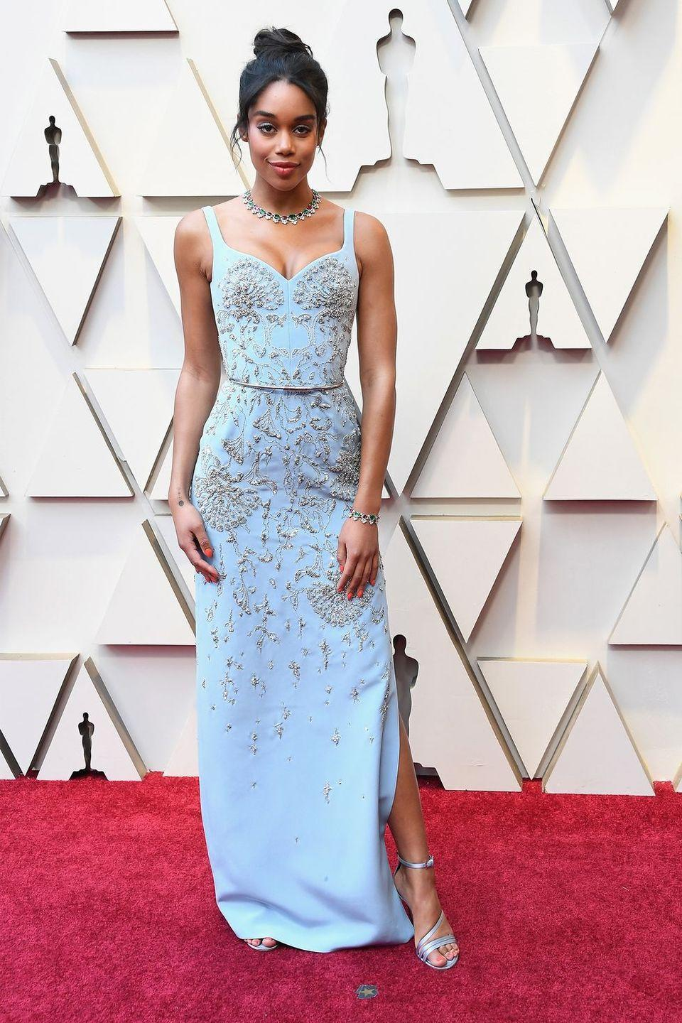 <p>Laura Harrier brought the capital F fashion to the red carpet in an ethical and eco-responsible Louis Vuitton creation. The gown was custom made in silk, embroidered with glass beads, Swarovski crystal shards, and sequins.</p>