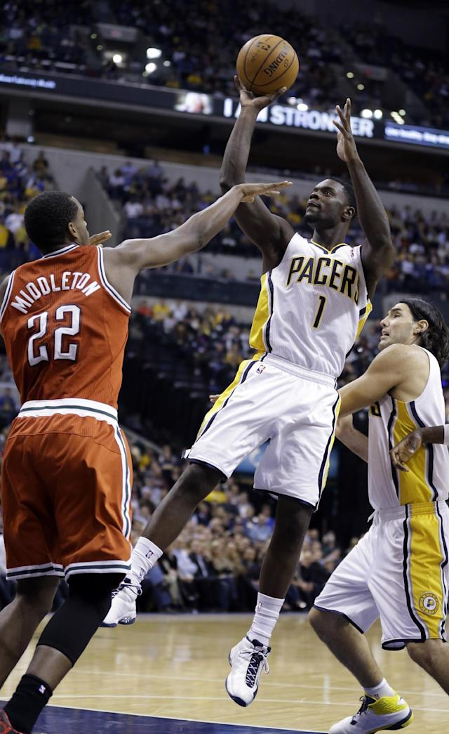 Indiana Pacers guard Lance Stephenson, right, shoots over Milwaukee Bucks forward Khris Middleton in the second half of an NBA basketball game in Indianapolis, Friday, Nov. 15, 2013. The Pacers defeated the Bucks 104-77. (AP Photo/Michael Conroy)