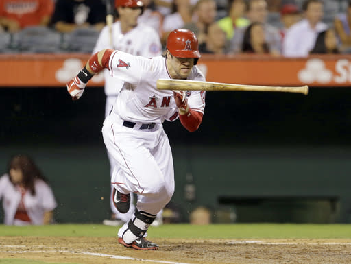 Los Angeles Angels' Collin Cowgill heads follows through on his one-run single, against the Tampa Bay Rays in the second inning of a baseball game in Anaheim, Calif., Tuesday, Sept. 3, 2013. (AP Photo/Reed Saxon)