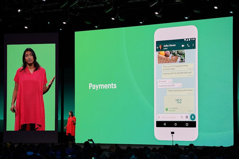 A woman presenting the payments feature on WhatsApp.