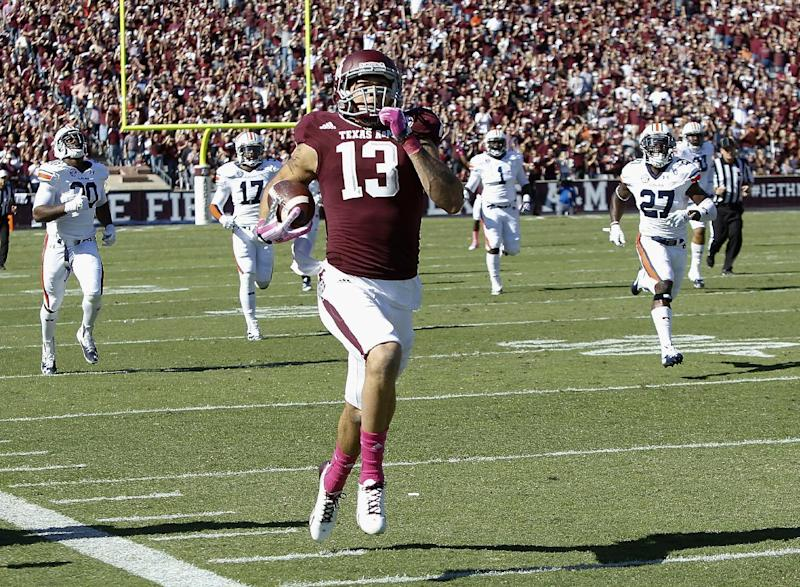 Texas A&M wide receiver Mike Evans (13) runs a 64-yard touchdown against Auburn in the first half during an NCAA college football game Saturday, Oct. 19, 2013, in College Station, Texas. (AP Photo/Bob Levey)
