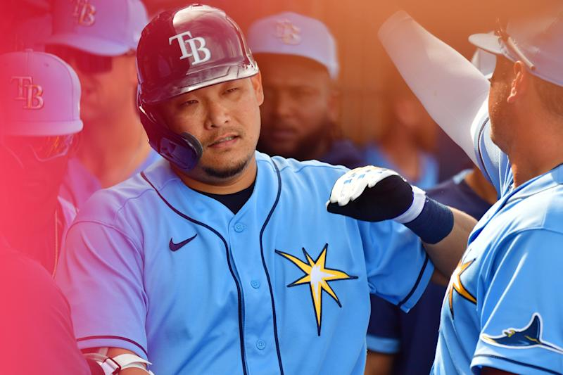 PORT CHARLOTTE, FLORIDA - FEBRUARY 24: Yoshitomo Tsutsugo #25 of the Tampa Bay Rays high fives teammates after hitting his first home run in the majors in the fourth inning against the Boston Red Sox at Charlotte Sports Park on February 24, 2020 in Port Charlotte, Florida. (Photo by Julio Aguilar/Getty Images)