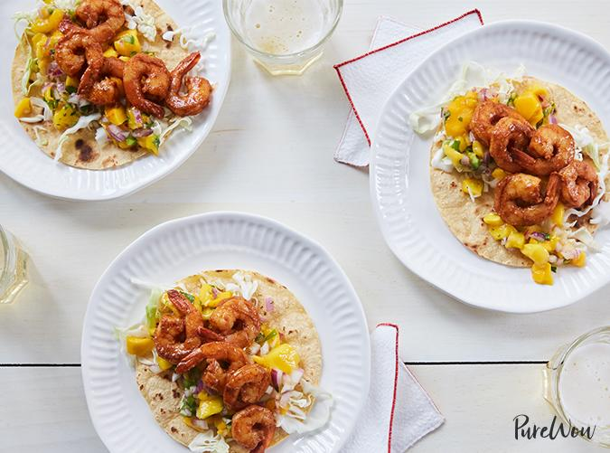 """<p>Best paired with a cold glass of white wine.</p> <p><a class=""""cta-button-link"""" href=""""https://www.purewow.com/recipes/spicy-shrimp-tacos-mango-salsa-recipe"""" target=""""_blank"""">Get the recipe</a></p>"""