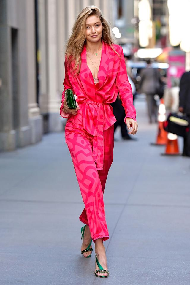 <p>In a March11 silk suit with emerald green heels, a Prada bag and a Kailinz necklace while out in New York City.</p>