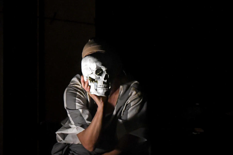 """Luana Stoica of the Jewish State Theatre performs, wearing a face masks for protection against COVID-19 infection, during the rehearsals for the premiere of the """"The Beautiful Days of My Youth"""" play, based on the diary of Romanian Jewish Holocaust survivor Ana Novac, in Bucharest, Thursday, Oct. 15, 2020. Friday's debut of """"The Beautiful Days of My Youth"""" by Romanian Jewish Holocaust survivor Ana Novac follows the National Holocaust Remembrance Day commemorations on Oct. 9, the day when deportations of Romania's Jews and Roma began in 1941. (AP Photo/Andreea Alexandru)"""