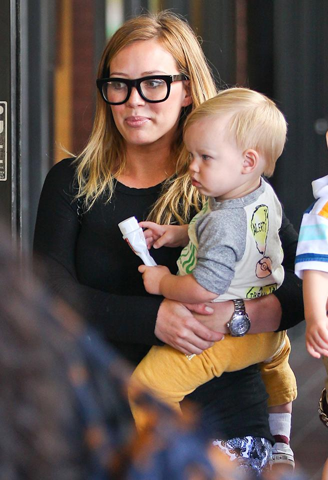 Hilary Duff went with the intellectual look when she took 1-year-old son Luca to a weekly baby class in Studio City, California, on Wednesday. (5/15/2013)