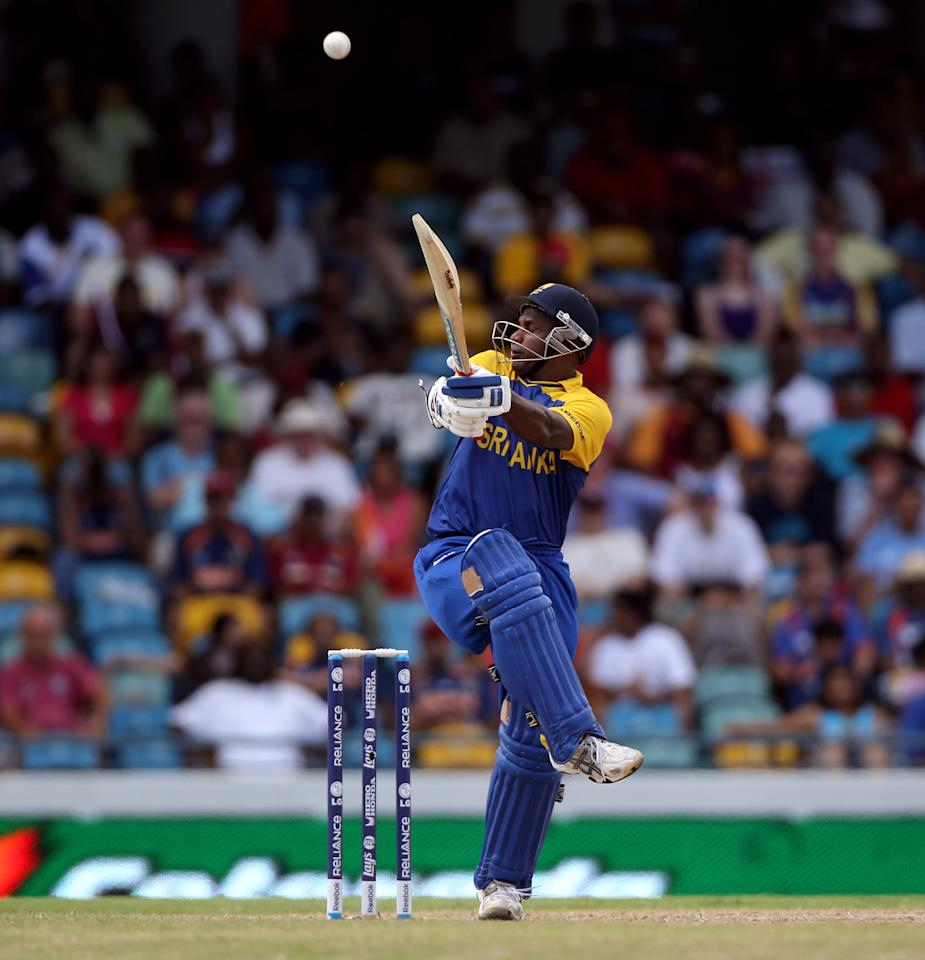 BRIDGETOWN, BARBADOS - MAY 07:  Sanath Jayasuriya of Sri Lanka hits out during The ICC World Twenty20 Super Eight Match between The West Indies and India played at The Kensington Oval on on May 7, 2010 in Bridgetown, Barbados.  (Photo by Julian Herbert/Getty Images)