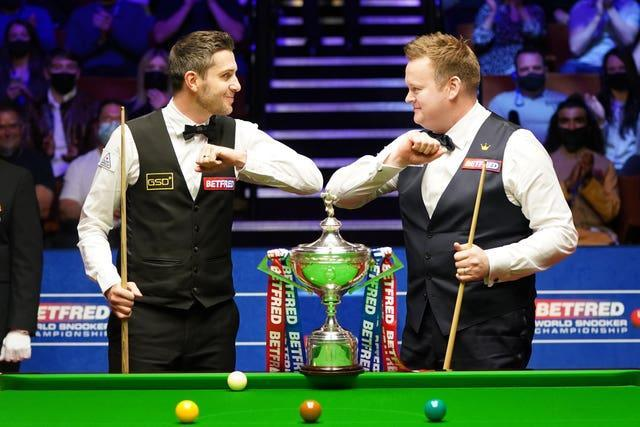 Mark Selby (left) and Shaun Murphy bump elbows before the start of the Betfred World Snooker Championships final