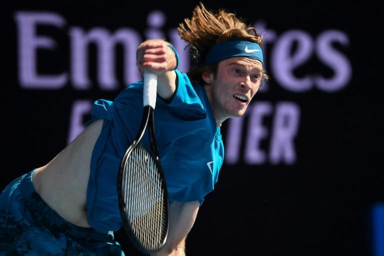 Andrey Rublev serves on his way to a rapid victory over against Casper Ruud
