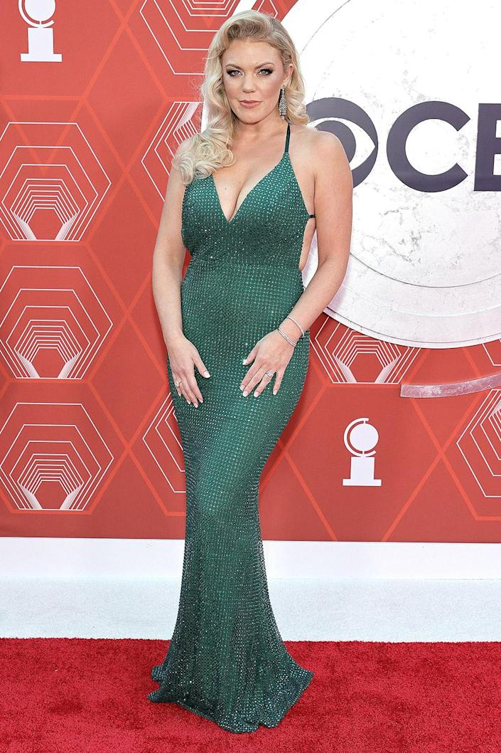 <p>Hurder, who currently appears in <em>Moulin Rouge</em>, wears a sequined green gown on the red carpet. </p>