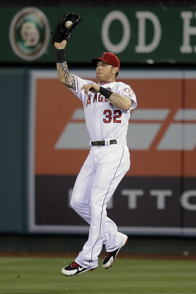 Los Angeles Angels' Josh Hamilton catches a fly ball hit by Seattle Mariners' Kyle Seager during the fifth inning of a baseball game in Anaheim, Calif., Tuesday, June 18, 2013. (AP Photo/Jae C. Hong)