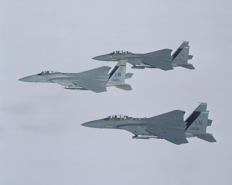 Three Boeing F-15s in flight.