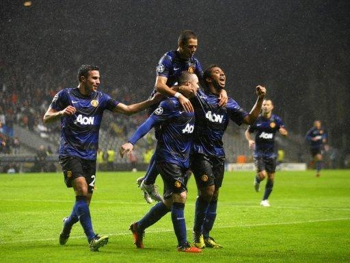 Manchester United's players celebrate scoring a goal during their UEFA Champions League Group H match against Braga, at the Municipal stadium of Braga, on November 7. Manchester won 3-1