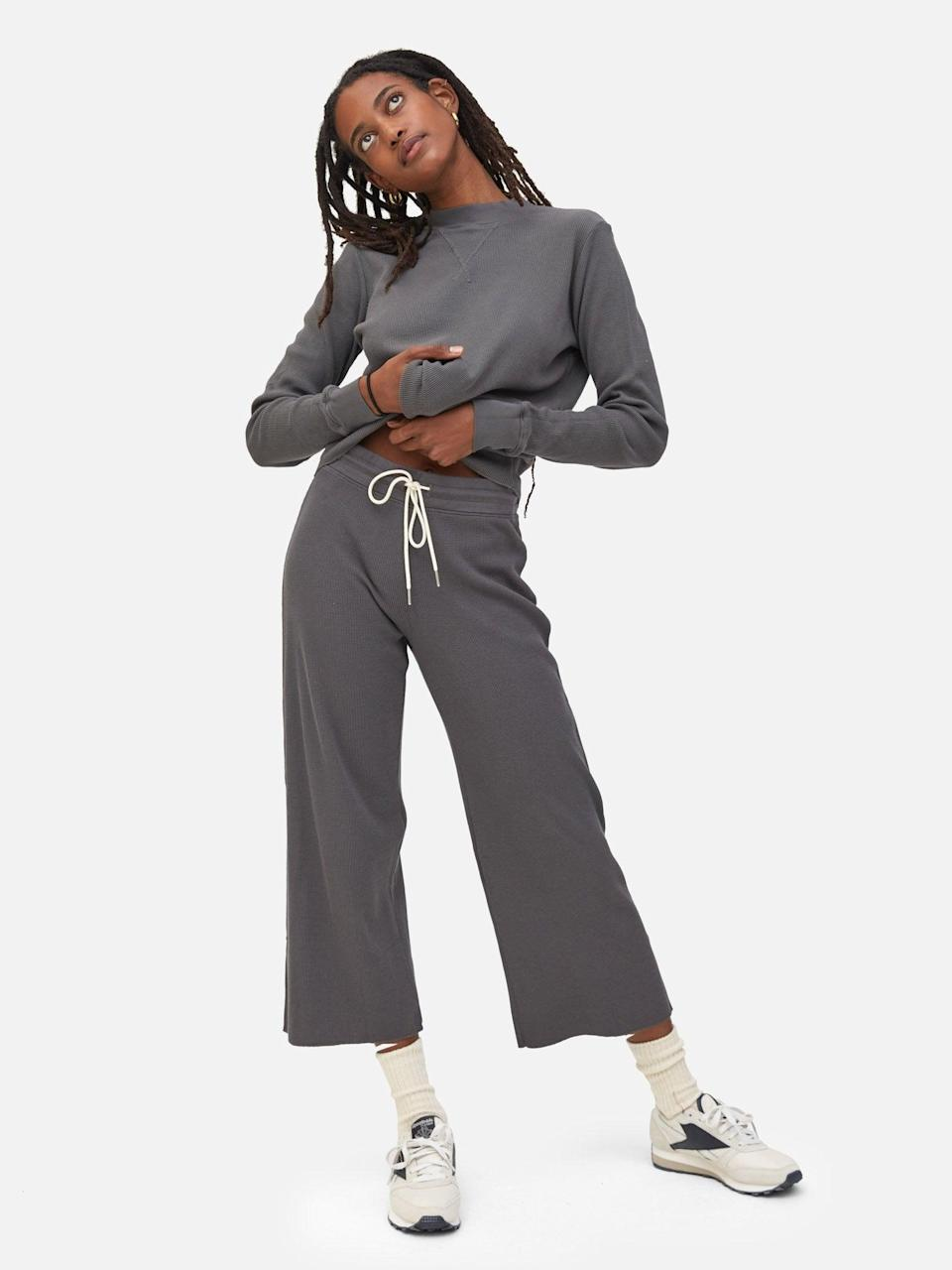 """<h2>Mate Organic Thermal Wide-Leg Pant & Boxy Crop</h2><br><strong>Available Sizes: XS-3X</strong><br>Mate The Label offers a handful of incredibly cozy, cute, and eco-conscious waffle/thermal-style knits that can be mix and matched for the ultimate stay-at-home look. We particularly love the brand's wide-leg pants paired with its boxy crop in this soothing slate-blue hue.<br><br><em>Shop <strong><a href=""""https://matethelabel.com/search?type=product&q=waffle"""" rel=""""nofollow noopener"""" target=""""_blank"""" data-ylk=""""slk:Mate The Label"""" class=""""link rapid-noclick-resp"""">Mate The Label</a></strong></em><br><br><strong>Mate</strong> Organic Thermal Wide Leg Pant, $, available at <a href=""""https://go.skimresources.com/?id=30283X879131&url=https%3A%2F%2Fmatethelabel.com%2Fproducts%2Forganic-thermal-wide-leg-pant-charcoal"""" rel=""""nofollow noopener"""" target=""""_blank"""" data-ylk=""""slk:Mate"""" class=""""link rapid-noclick-resp"""">Mate</a><br><br><strong>Mate</strong> Organic Thermal Boxy Crop, $, available at <a href=""""https://go.skimresources.com/?id=30283X879131&url=https%3A%2F%2Fmatethelabel.com%2Fproducts%2Forganic-thermal-boxy-crop-charcoal"""" rel=""""nofollow noopener"""" target=""""_blank"""" data-ylk=""""slk:Mate"""" class=""""link rapid-noclick-resp"""">Mate</a>"""