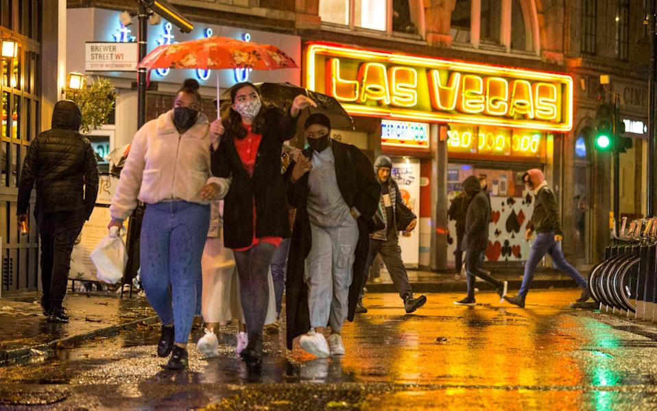 Despite the rainy weather and Tier 2 lockdown, revellers hit the streets of Soho in central London this weekend - Marcin Nowak/LNP