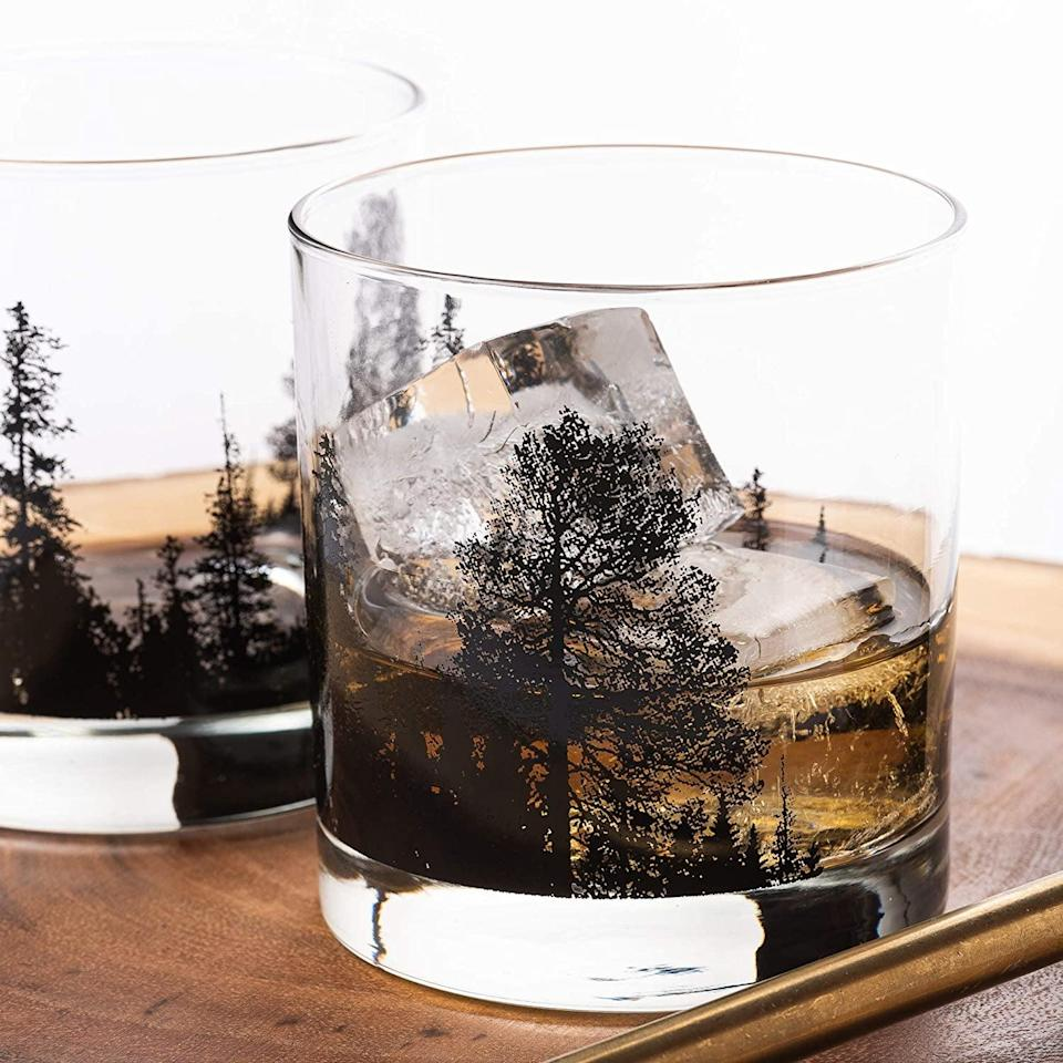 <p>Give their bar setup an upgrade with these <span>Forest Landscape Whiskey Glasses</span> ($29 for two). It's perfect for the one who loves to sip on a glass of their favorite whiskey after a long day. If they resonate with the outdoors, they'll absolutely love this set.</p>