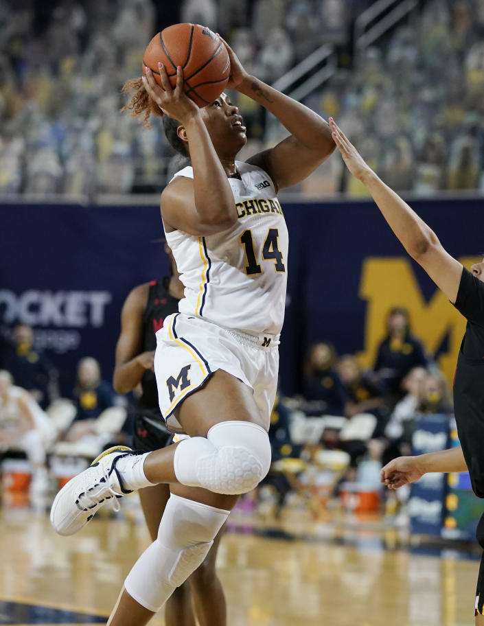 Michigan guard Akienreh Johnson (14) attempts a shot during the first half of an NCAA college basketball game against Maryland, Thursday, March 4, 2021, in Ann Arbor, Mich. (AP Photo/Carlos Osorio)