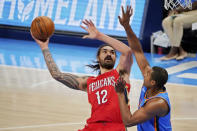New Orleans Pelicans center Steven Adams shoots in front of Oklahoma City Thunder center Al Horford, right, during the second half of an NBA basketball game Thursday, Dec. 31, 2020, in Oklahoma City. (AP Photo/Sue Ogrocki)