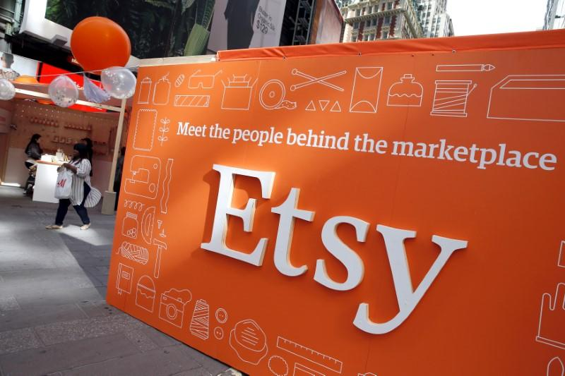 FILE PHOTO - A sign advertising the online seller Etsy Inc. is seen outside the Nasdaq market site in Times Square following Etsy's IPO in New York