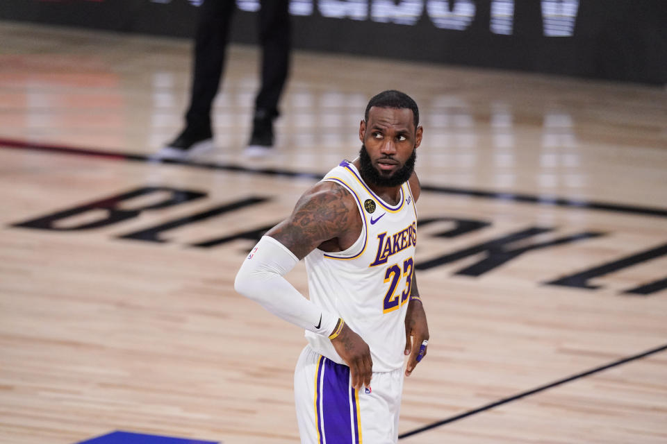 Los Angeles Lakers' LeBron James (23) looks on after scoring and being fouled during the first half in Game 3 of basketball's NBA Finals against Miami Heat, Sunday, Oct. 4, 2020, in Lake Buena Vista, Fla. (AP Photo/Mark J. Terrill)