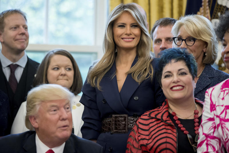 First lady Melania Trump, center, stands next to President Donald Trump, left, during a National Teacher of the Year event in the Oval Office at the White House in Washington, Wednesday, April 26, 2017. Today is first lady Melania Trump's birthday. (AP Photo/Andrew Harnik)