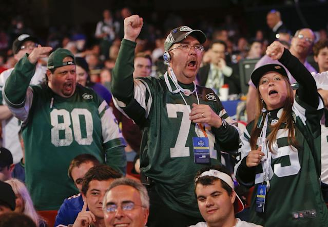 New York Jets fans react to the Jets' third round pick, Dexter McDougal of Maryland, during the 2014 NFL Draft, Friday, May 9, 2014, in New York. (AP Photo/Jason DeCrow)