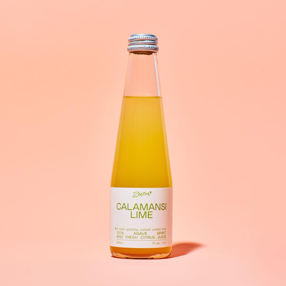 """This uniquely tart, glass-bottled cocktail offers the perfect amount of sour and effervescence. The ingredient list is both shockingly short—just water, agave spirit, sea salt, and lime juice—and transparently sourced. (According to the website, Zuzu's makers are committed to purchasing directly from supplies, which starts on a family-owned agave farm in Jalisco, Mexico.) $23, Zuzu. <a href=""""https://shop.drinkzuzu.com/products/calamansi-lime"""" rel=""""nofollow noopener"""" target=""""_blank"""" data-ylk=""""slk:Get it now!"""" class=""""link rapid-noclick-resp"""">Get it now!</a>"""
