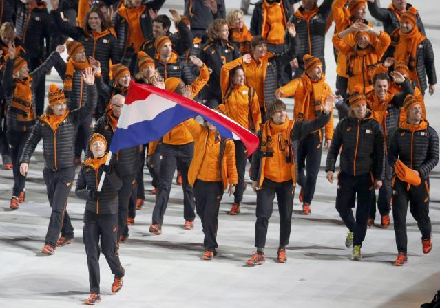 Flag-bearer Jorien ter Mors of the Netherlands leads her country's contingent during the opening ceremony of the 2014 Sochi Winter Olympics, February 7, 2014. REUTERS/Mark Blinch (RUSSIA - Tags: OLYMPICS SPORT)
