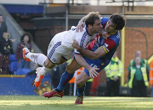 Crystal Palace's Mile Jedinak, right, tussles with Chelsea's Branislav Ivanovic during their English Premier League soccer match at Selhurst Park, London, Saturday, March 29, 2014. (AP Photo/Sang Tan)