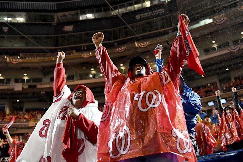 WASHINGTON, DC - OCTOBER 30: Washington Nationals fans celebrate at the Watch Party for Game 7 of the World Series against the Houston Astros at Nationals Park October 30, 2019 in Washington, DC. The Washington Nationals beat the Houston Astros 6-2 to win the World Series. (Photo by Katherine Frey/The Washington Post via Getty Images)