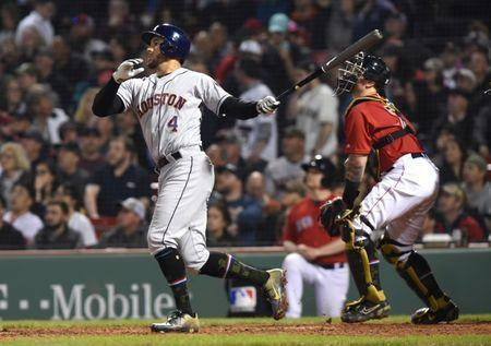 May 17, 2019; Boston, MA, USA; Houston Astros designated hitter George Springer (4) hits a two-run home run during the eighth inning against the Boston Red Sox at Fenway Park. Bob DeChiara-USA TODAY Sports