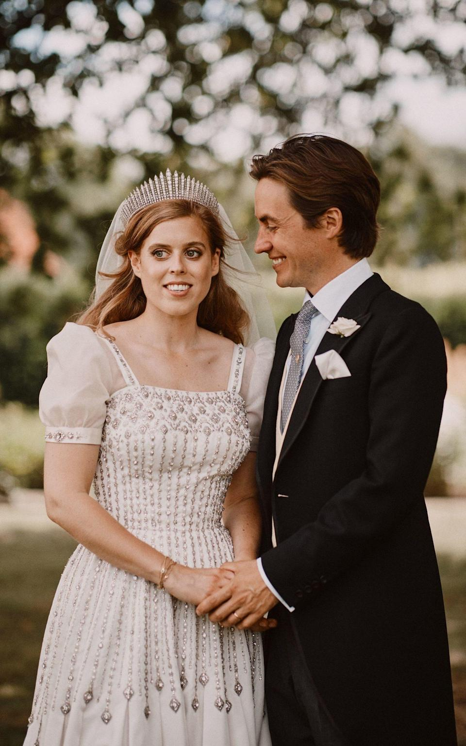 Princess Beatrice and Edoardo Mapelli Mozzi in the grounds of the Royal Lodge, after their wedding - Benjamin Wheeler/PA