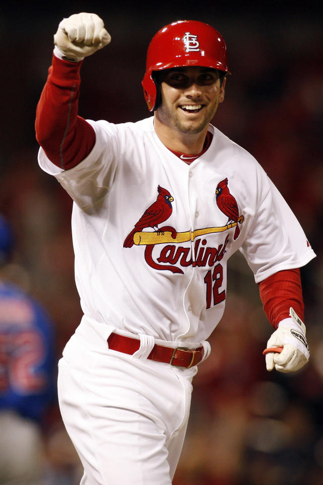 St. Louis Cardinals' Greg Garcia pumps his fist as he runs to the plate after getting hit by a pitch resulting in the winning run scoring during the twelfth inning of a baseball game against the St. Louis Cardinals Tuesday, May 13, 2014, in St. Louis. (AP Photo/Scott Kane)