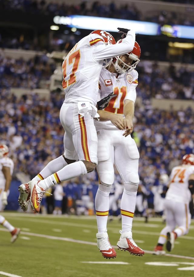 After scoring a touchdown against the Indianapolis Colts, Kansas City Chiefs wide receiver Donnie Avery (17) celebrates with quarterback Alex Smith (11) during the first half of an NFL wild-card playoff football game Saturday, Jan. 4, 2014, in Indianapolis. (AP Photo/Michael Conroy)
