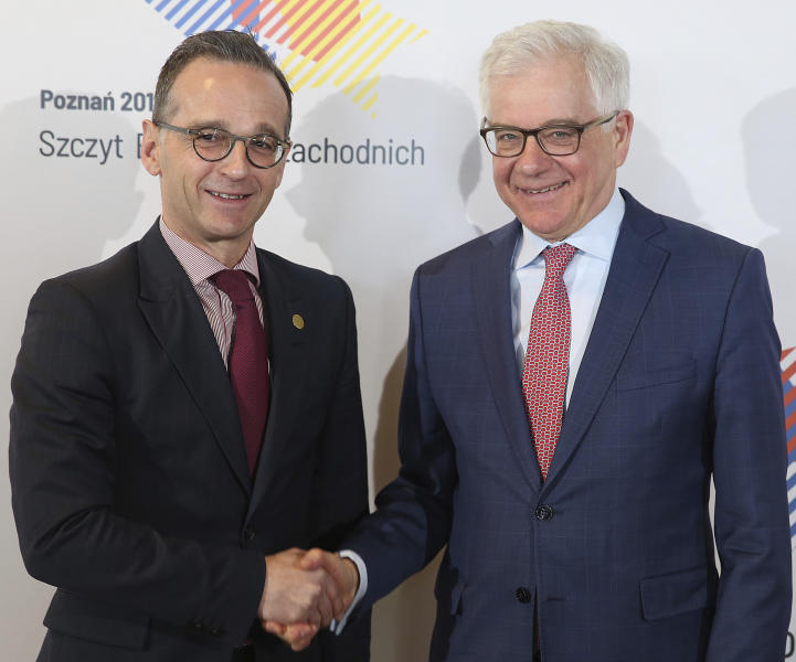 Polish Foreign Minister Jacek Czaputowicz, right, and his German counterpart Heiko Maas shake hands prior to the Berlin Process Foreign Ministers meeting in Warsaw, Poland, Friday, April 12, 2019. The Berlin Process is an initiative to boost regional cooperation among the Western Balkan countries and their European integration. (AP Photo/Czarek Sokolowski)