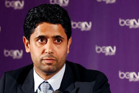 FILE PHOTO: Nasser Al-Khelaifi (L), Paris St Germain's club owner and owner of Qatari TV channel Al Jazeera Sport, President of beIN Sport French TV channel, attends a news conference in Paris May 24, 2012. Picture taken May 24, 2012. REUTERS/Jacky Naegelen