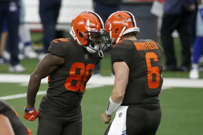 Jarvis Landry and Baker Mayfield celebrate after Landry threw a touchdown pass to Odell Beckham Jr.