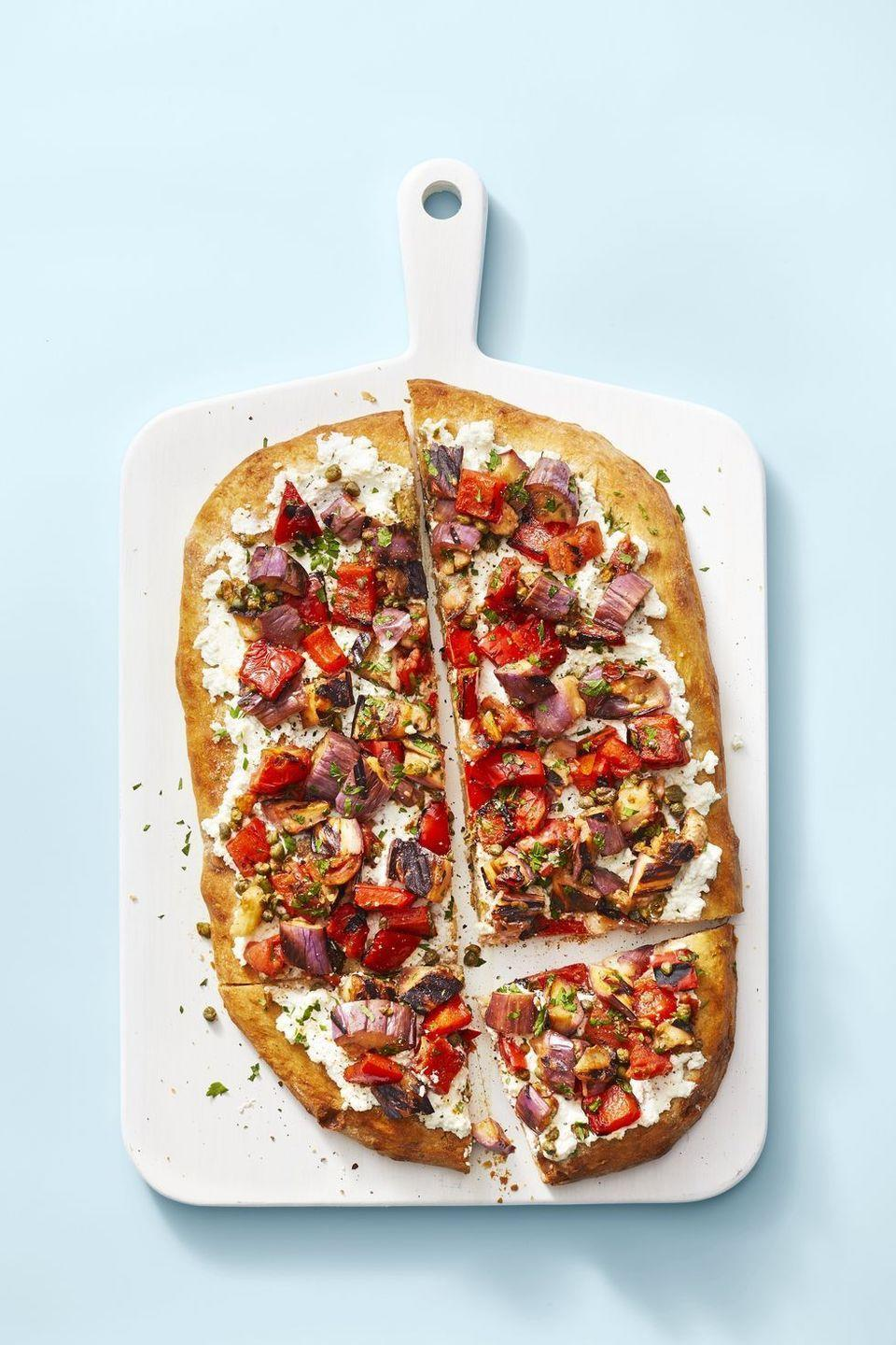 "<p>Yep, sweet and vinegary eggplant is the flavor-packed <a href=""https://www.goodhousekeeping.com/food-recipes/cooking/a32714182/how-to-make-pizza-at-home-recipe/"" rel=""nofollow noopener"" target=""_blank"" data-ylk=""slk:pizza"" class=""link rapid-noclick-resp"">pizza</a> topping you've been looking for.</p><p><em><a href=""https://www.goodhousekeeping.com/food-recipes/easy/a28210300/caponata-flatbread-recipe/"" rel=""nofollow noopener"" target=""_blank"" data-ylk=""slk:Get the recipe for Caponata Flatbread »"" class=""link rapid-noclick-resp"">Get the recipe for Caponata Flatbread »</a></em></p>"