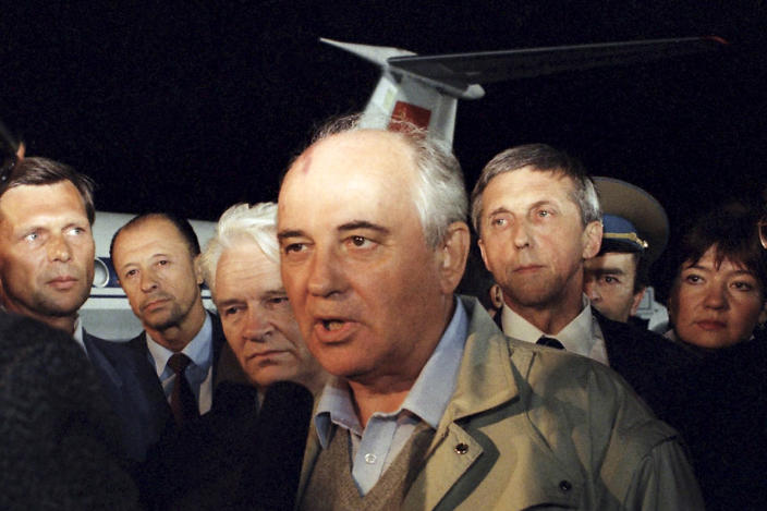 FILE - In this Thursday, Aug. 22, 1991 file photo, Soviet President Mikhail Gorbachev speaks to a Soviet TV newsman at Vnukovo airport outside Moscow, shortly after arriving from the Crimea after a three day coup by Communist hard-liners failed, in Russia. When a group of top Communist officials ousted Soviet leader Mikhail Gorbachev 30 years ago and flooded Moscow with tanks, the world held its breath, fearing a rollback on liberal reforms and a return to the Cold War confrontation. But the August 1991 coup collapsed in just three days, precipitating the breakup of the Soviet Union that plotters said they were trying to prevent. (AP Photo, File)
