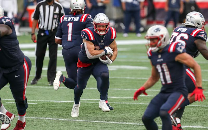 New England Patriots running back Rex Burkhead (34) runs the ball during the second half against the Las Vegas Raiders at Gillette Stadium.  - Paul Rutherford-USA TODAY Sports