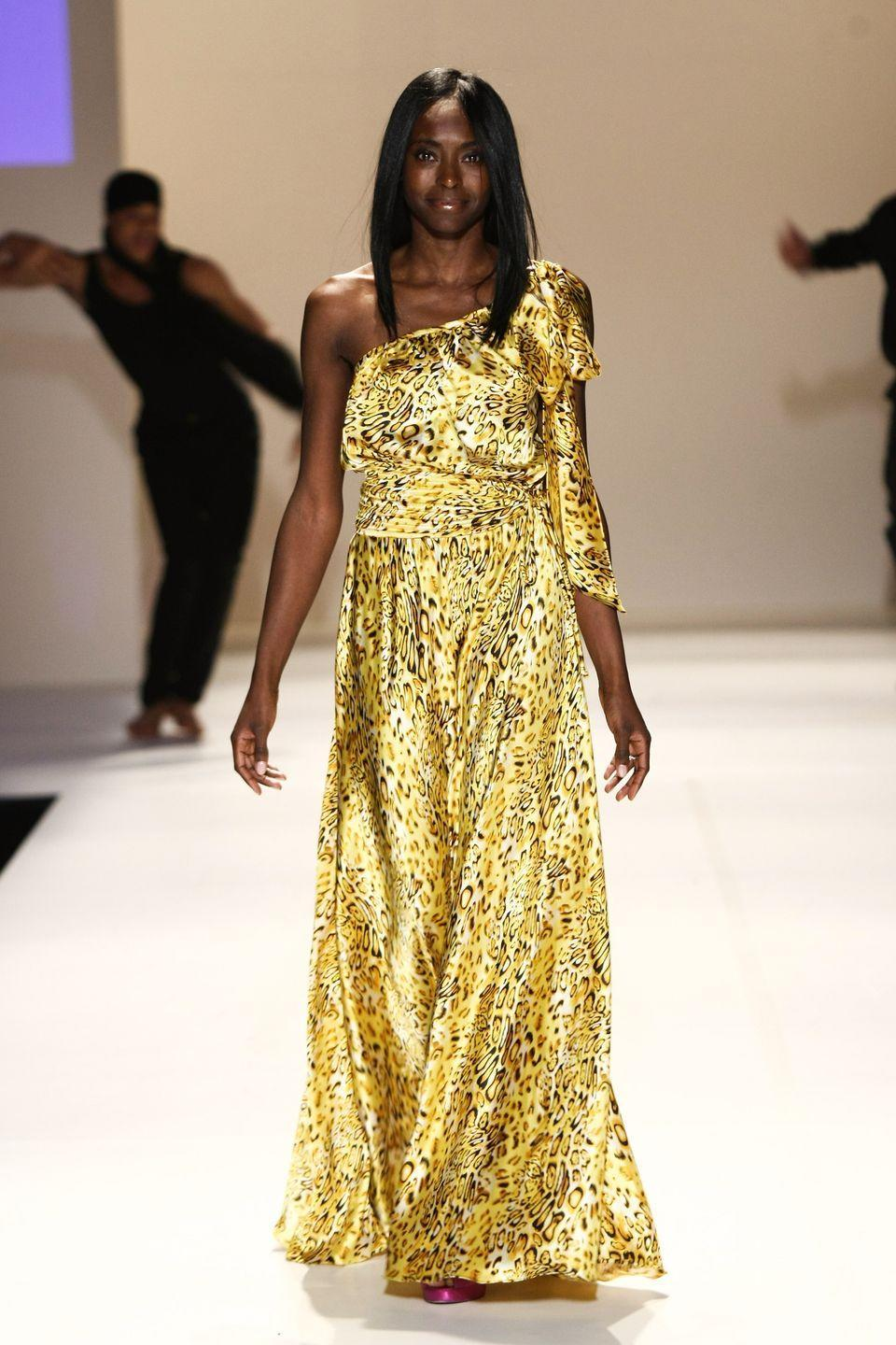 <p>The Princess, who is also known for being the face of Pantene, often walks in shows at various Fashion Weeks. Here, Keisha was photographed rehearsing for the Code Purple fall 2012 fashion show in a vibrant animal print gown. </p>