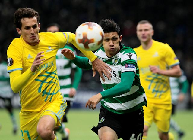 Soccer Football - Europa League Round of 32 First Leg - Astana vs Sporting CP - Astana Arena, Astana, Kazakhstan - February 15, 2018 Sporting's Fredy Montero in action with Astana's Yuriy Logvinenko REUTERS/Alexei Filippov TPX IMAGES OF THE DAY