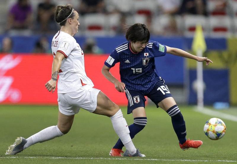 England's Lucy Bronze, left, and Japan's Jun Endo, right, challenge for the ball during the Women's World Cup Group D soccer match between Japan and England at the Stade de Nice in Nice, France, Wednesday, June 19, 2019. (AP Photo/Claude Paris)