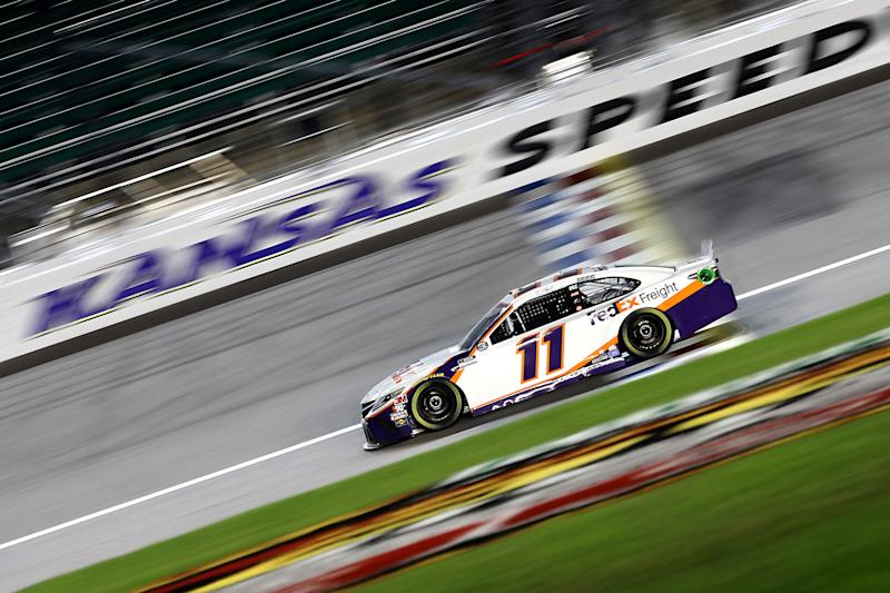 KANSAS CITY, KANSAS - JULY 23: Denny Hamlin, driver of the #11 FedEx Office Toyota, races during the NASCAR Cup Series Super Start Batteries 400 Presented by O'Reilly Auto Parts at Kansas Speedway on July 23, 2020 in Kansas City, Kansas. (Photo by Jamie Squire/Getty Images)