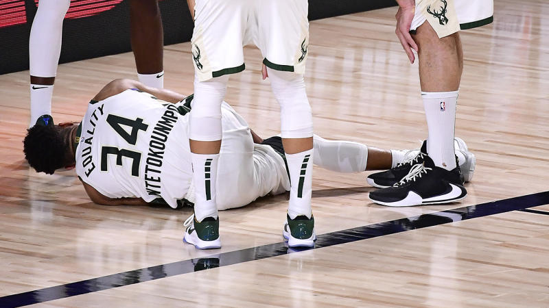 Giannis Antetokounmpoof the Milwaukee Bucks exits the game after an injury during the second quarter against the Miami Heat in Game Four of the Eastern Conference Second Round. (Photo by Douglas P. DeFelice/Getty Images)